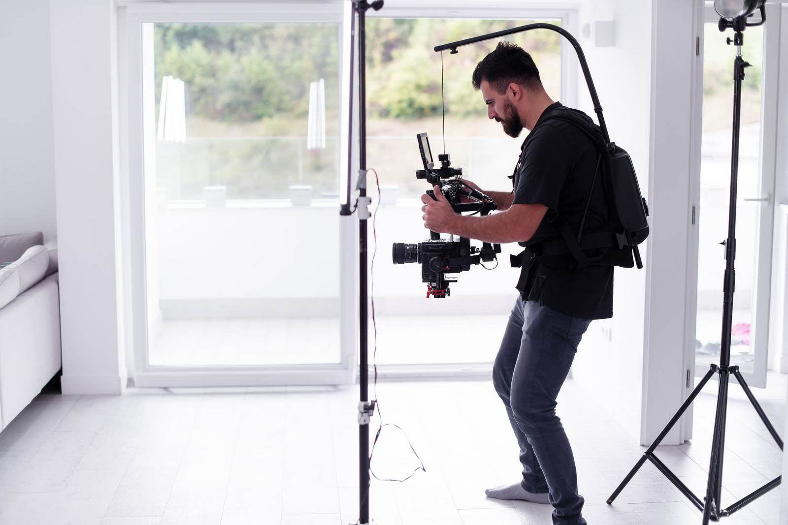 Image of a videographer shooting footage of the interior of a house.
