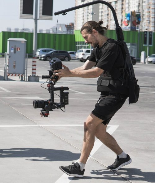 Image of our staff at Elite Video of Raleigh shoowing some footage out in a parking lot.
